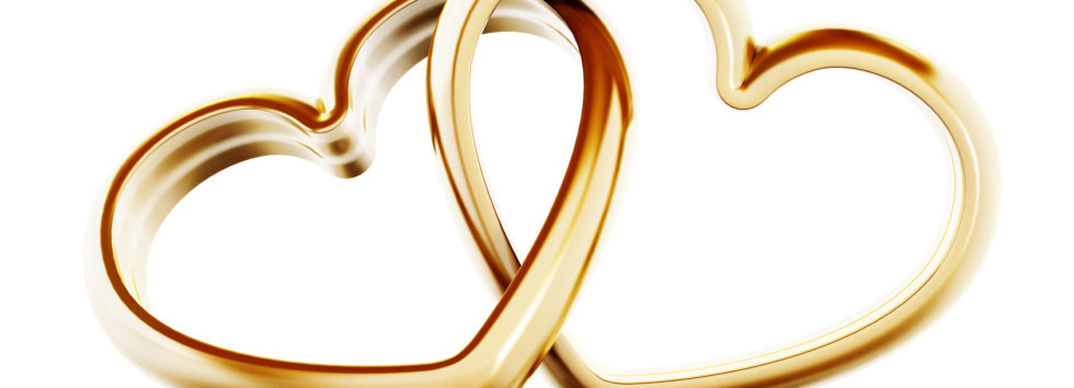 Gold heart shaped rings attached to each other. 3D illustration